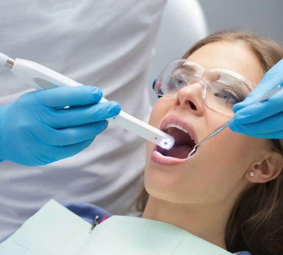 Dental exam using an intraoral camera.